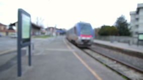 Blurred Departure of a Passenger Train. In an Italian train Station. Blurred Video stock video footage