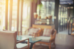 Blurred desk and chairs in coffee shop Royalty Free Stock Image