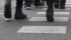 Blurred detail of feet across a crosswalk. 01-01. Blurred detail of feet across a crosswalk front and back view, on a street in Barcelona stock video