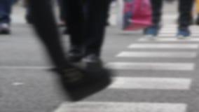 Blurred detail of feet across a crosswalk. 01-06. Blurred detail of feet across a crosswalk front and back view, on a street in Barcelona stock footage