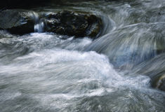 Blurred detail of a mountain stream stock images