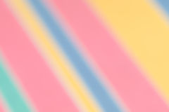 Blurred diagonal candy stripes spring and summer background. Stock Images