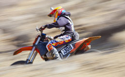 Blurred Dirt Bike Racer Stock Images