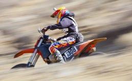 Blurred Dirt Bike Racer Stock Images