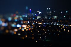Blurred dramatic night view of city with abstract of LED, neon lights and beautiful bokeh. Blurred dramatic night view of city with abstract of LED, neon lights Stock Photo