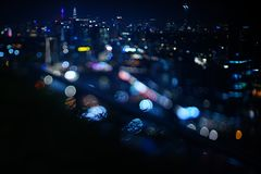 Blurred dramatic night view of city with abstract of LED, neon lights and beautiful bokeh. Blurred dramatic night view of city with abstract of LED, neon lights Royalty Free Stock Photo