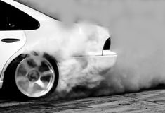 Blurred of drift car, Car wheel drifting and smoking. On track stock images
