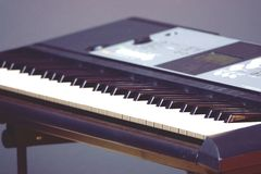 Blurred Electronic musical keyboard synthesizer close-up stock photos