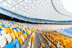 Blurred empty football stadium with stands. 2016 sport background.  Royalty Free Stock Photos