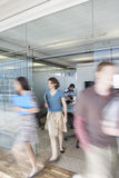 Blurred Executives Leaving Conference Room. Full length of blurred office workers leaving conference room Royalty Free Stock Photography