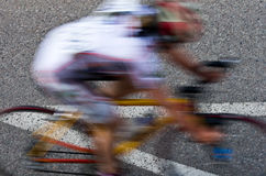 Blurred female road cyclist. A figure (profile) of a female road cyclist, motion blur applied Royalty Free Stock Photography