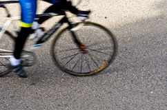 Blurred female road cyclist Stock Images