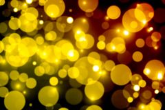Blurred festive bokeh background,yellow circles on dark, Christm. Abstract  light  background  blurred  glow  design  color  bokeh  decoration  bright  magic Royalty Free Stock Photography