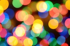 Blurred festive colorful lights over black useful as background. All main colors included. Red, yellow, green and blue.  Stock Photos