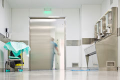 Blurred figure exiting hospital door Royalty Free Stock Images