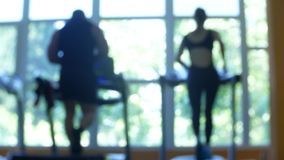 Blurred fitness gym people cardio workout in sport club center. 4k. Blurred fitness gym people cardio workout in sport club center. 4k stock footage