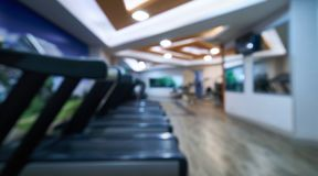 Blurred of fitness gym room background. For banner presentation, healthy lifestyle concept Stock Photo