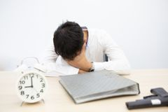 Blurred focus. Businessmen are dismayed at business problems. Depressive, unhappy male wants to commit suicide. Businessman with stock photography