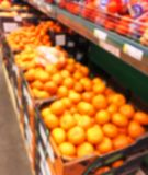 Blurred fresh fruits and vegetables at retail store. Abstract background of supermarket. Grocery market blurred background. Fruits. In store racks. Interior stock photography