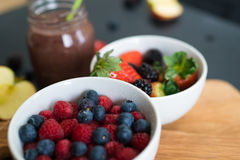 Blurred fruit bowls stock image