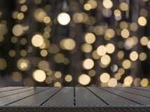 Free Blurred Gold Garland And Wooden Tabletop As Foreground. Image For Display Your Christmas Products. Stock Photography - 104019002