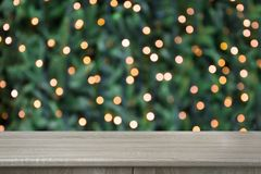 Free Blurred Gold Garland On Christmas Tree And Wooden Tabletop As Foreground. Image For Display Or Montage Your Christmas Products. Stock Photo - 128277490