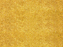 Blurred gold glitter Stock Photos