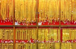 Blurred gold, panel gold shop jewelry store for seller recommend products and gold showcase, blur gold shop background royalty free stock photos