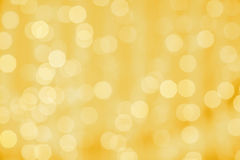 Blurred golden background with bokeh lights Stock Photos