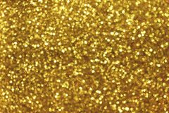 Blurred golden background with circle sparkling lights. Shiny yellow glittery bokeh of christmas garland. Dark backdrop stock image