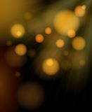 Blurred golden bubbles shimmering background Royalty Free Stock Images