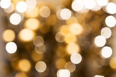Blurred golden christmas lights bokeh Stock Photos