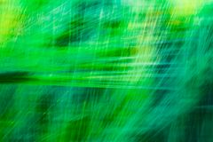 Blurred green abstract background with a predominance of lines. Based on a plant Stock Image