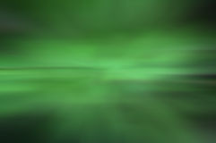 Blurred green background. Light movements Stock Photo