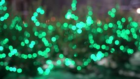 Blurred Green Christmas Lights Glow And Flash. On A City Street. The Concept Of Celebrating The New Year And Christmas. New Year`s Intro stock footage