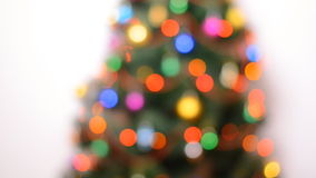 Blurred Green Christmas Tree with Gifts and Bulbes Blinking stock video
