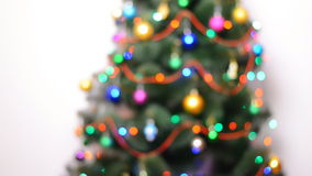 Blurred Green Christmas Tree with Gifts and Bulbes Blinking stock video footage