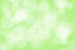 Blurred green sparkles. Blurred green background. Circle light Stock Photography