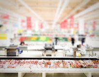 Blurred grocery store with isolated ham and sausage royalty free stock photography