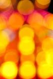 Blurred ha colorato i punti su un fondo nero Fotografia Stock