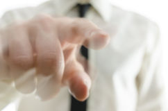 Blurred hand pointing finger towards you. Detail of blurred businessman hand pointing finger towards you royalty free stock photos