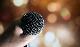 Blurred of hands businesswoman speech and speaking with micropho. Nes in seminar room or talking conference hall light with microphones and keynote. Speech is Stock Image