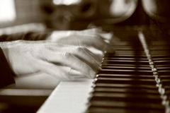 Blurred hands on piano Royalty Free Stock Image