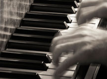 Blurred Hands Playing Piano, Sepia Stock Photos