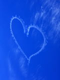 Blurred heart in blue sky skywriting Stock Image