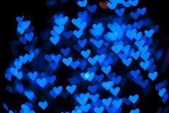 Blurred of heart shape christmas light Stock Photos