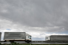 Blurred heavy trucks on highway Royalty Free Stock Photo