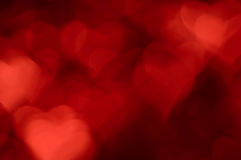 Blurred holiday background with red hearts Royalty Free Stock Image