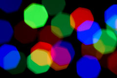 Blurred holiday colorful lights over black Royalty Free Stock Image