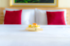 Blurred hotel room with bed and flower arrangement Royalty Free Stock Photography